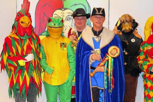 Michael Wilke (2.v.r.) und Jörg Roßkopf mit Güggel, Frosch und Schnägg  Fotos: Bernhartd Konrad Foto: Die Oberbadische
