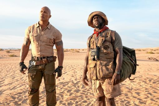 "Dr. Smolder Bravestone (Dwayne Johnson, l.) und Moose Finbar (Kevin Hart, r.) in ""Jumanji: The next Level""   Foto: zVg / Sony Pictures Foto: Die Oberbadische"