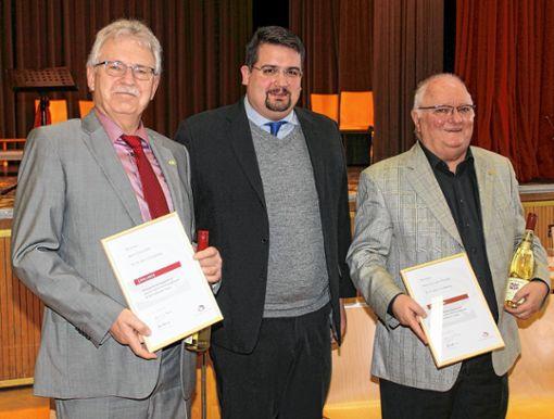 Dirigieren seit 50 Jahren: Erhard Zeh, Markus Bertelsmann und Hermann Thomann.    Foto: Heiner Fabry Foto: Markgräfler Tagblatt